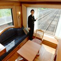 Riding in style: A spacious suite in the Seven Stars in Kyushu, the new luxury train operated by Kyushu Railway Co., is unveiled to the press earlier this month. The train departs from JR Hakata Station on Tuesday. | KYODO