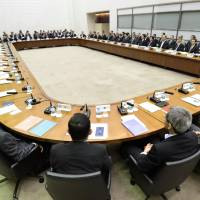 Nation's economic ayes: The Bank of Japan's executives and regional branch managers meet Monday at the central bank's headquarters in Tokyo. | KYODO