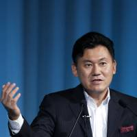 Staying the course: Hiroshi Mikitani, chairman and chief executive officer of Rakuten Inc., speaks at the 15th Nikkei Global Management Forum in Tokyo on Monday. | BLOOMBERG
