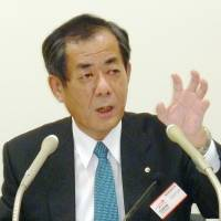 Damage control: Orient Corp. President Masayuki Saito holds a news conference in Tokyo on Wednesday. | KYODO