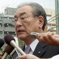 Fish wish: Hiroshi Kishi, head of JF Zengyoren, faces reporters Tuesday outside the South Korean Embassy in Tokyo. | KYODO