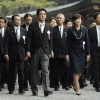 Shinto rounds: Prime Minister Shinzo Abe and his wife, Akie, visit Ise Shrine in Mie Prefecture on Wednesday to attend the Shikinen Sengu ceremony, during which enshrined objects are transferred to new Inner and Outer shrine buildings every 20 years. | KYODO