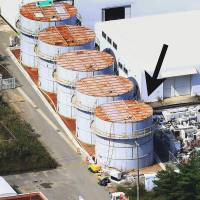 Plug me: An arrow points to a storage tank at the Fukushima No. 1 power plant that accidentally leaked 430 liters of radioactive water into the Pacific Ocean, according to a disclosure this week by Tokyo Electric Power Co. | KYODO