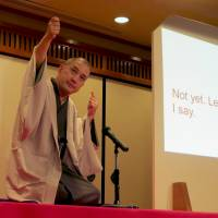 Breaking barriers: 'Rakugo' master Shunputei Ichinosuke performs his 'sit-down' comedy routine with English subtitles in Tokyo recently. | KYODO