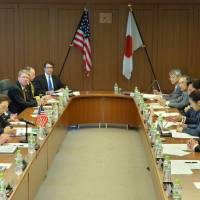 Common goals: U.S. Defense Secretary Chuck Hagel (second from left) holds talks with Defense Minister Itsunori Onodera (fourth from right) in Tokyo on Thursday. | AFP-JIJI
