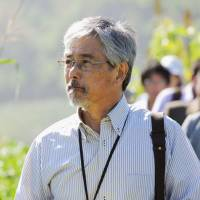 Grave concern: Kyoto University professor Naoki Mizuno surveys burial sites in eastern North Korea on Sept. 1. | KYODO