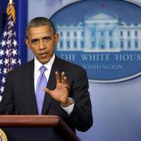The victor: President Barack Obama fields questions at the  White House on Wednesday. | KYODO