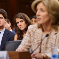 Family support: John 'Jack' Schlossberg and his sister, Tatiana, watch their mother, Caroline Kennedy, testify before the Senate Foreign Relations Committee in Washington on her nomination to be ambassador to Japan. | AFP-JIJI