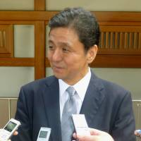 Paying homage: Senior Vice Foreign Minister Nobuo Kishi, the younger brother of Prime Minister Shinzo Abe, is interviewed by the press Saturday after paying a visit to Yasukuni Shrine in Tokyo. | KYODO