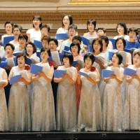 Live from New York: Singers from the Fukushima Mothers' Chorus Association sing at Carnegie Hall in New York City on Saturday. | KYODO