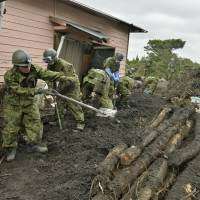Short of time: As the season's 27th typhoon, Francisco, approaches Japan Thursday, Self-Defense Forces members continue the search for the missing residents on Izu-Oshima Island, which was hit hard last week by the season's 26th typhoon, Wipha. | KYODO