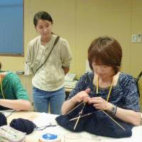 Sewing success: Tamako Mitarai, president of Kesennuma Knitting Co., watches women hone their knitting skills in disaster-hit Kesennuma, Miyagi Prefecture. | KYODO
