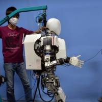 Hip to be square: A  Wabian-2 robot demonstrates its ability to walk  Tuesday. | AFP-JIJI