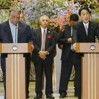 Full-on Fukushima : Foreign Minister Fumio Kishida (right) speaks to reporters at a news conference Saturday following a Pacific Islands Forum meeting in Tokyo. | KYODO