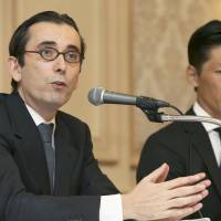 Oriol Montal (left), general manager of Ritz-Carlton Osaka, attributes the luxury hotel's deceiving menus to human error during a news conference Saturday in the city of Osaka. | KYODO