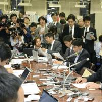 Mizuho offers denials as heads roll over mob loans