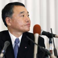 Checking out: Hankyu Hanshin Hotels Co. President Hiroshi Desaki faces the media on Monday in Osaka after announcing he will step down over a false advertising scandal involving restaurant food. | KYODO