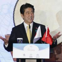 On track: Prime Minister Shinzo Abe speaks Monday at a ceremony marking the opening of an Istanbul subway tunnel partly financed by yen loans. | KYODO