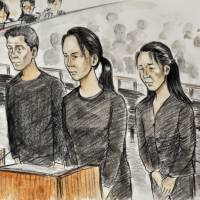 Mysterious deaths: Defendants (from left) Hiroyuki Kawamura, Kae Oe and Yumi Oe await sentencing at the Kobe District Court on Thursday. | KYODO
