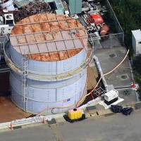 Can't hold water: One of the storage tanks for radioactive coolant that has leaked is seen earlier this month at the Fukushima No. 1 nuclear plant.  | KYODO