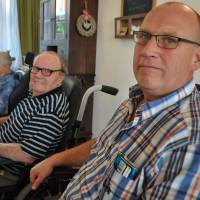 With a little help from our progeny: Henk Hom (right) sits beside his father at a retirement home in Stolwijk, in the central Netherlands, on Sept. 16. In order for his dad to enjoy the benefits of having a room at the facility, Hom assists him and other residents for four hours per month | AFP-JIJI