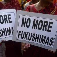 Shortage of power: Protesters hold placards during a Monday rally in Mumbai against nuclear power. Opposition has hardened since the eruption of the Fukushima atomic crisis | AFP-JIJI