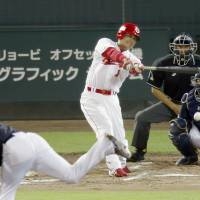 One last hurrah: Carp pinch hitter Tomonori Maeda, in his final regular-season appearance before retiring, grounds out in the eighth inning on Thursday against the Dragons at Mazda Stadium. Chunichi topped Hiroshima 5-3. | KYODO