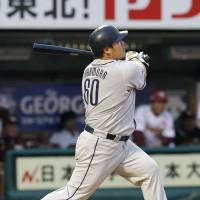 Pivotal moment: The Lions' Takeya Nakamura smacks a tiebreaking home run in the ninth inning against the Eagles at Kleenex Stadium on Saturday. Seibu defeated Tohoku Rakuten to 2-1 to clinch a Climax Series berth for the fourth year in a row. | KYODO