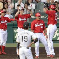 Happy afternoon: The Carp had plenty to celebrate on Saturday in Game 1 of the Central League Climax Series First Stage against the Tigers at Koshien Stadium. Hiroshima defeated Hanshin 8-1. | KYODO
