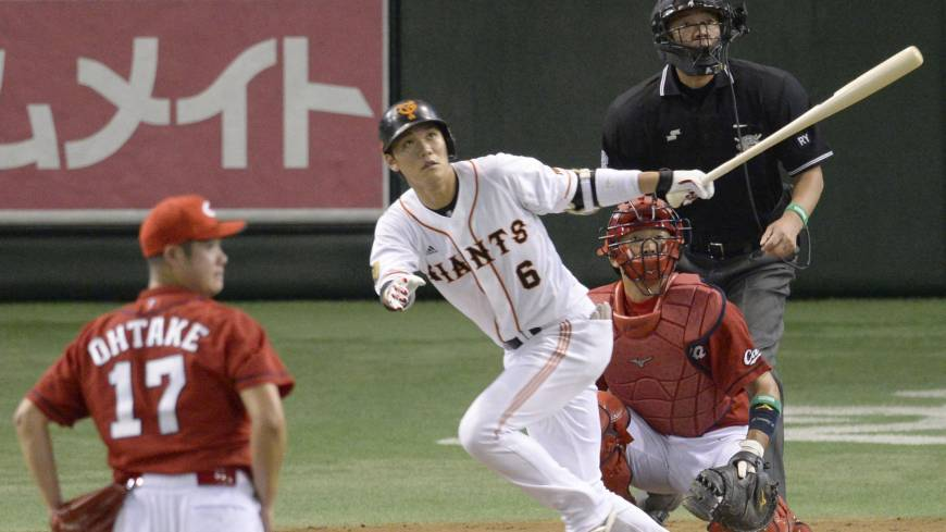 Providing a spark: Giants star Hayato Sakamoto belts a game-tying home run in the sixth inning against the Carp in Game 1 of the Central League Climax Series Final Stage on Wednesday at Tokyo Dome. Yomiuri beat Hiroshima 3-2.
