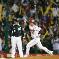 Eagle power: Tohoku Rakuten's Ginji Akaminai rounds the bases after hitting a fourth-inning home run in the Golden Eagles' 2-0 win over the Marines on Thursday. | KYODO