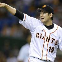 Count on me: Yomiuri starting pitcher Tomoyuki Sugano gestures during the Giants' 3-0 win over the Carp in Game 2 of the Central League Climax Series Final Stage on Thursday. | KYODO