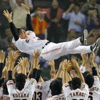 A sweet ride: Yomiuri Giants skipper Tatsunori Hara gets a victory toss after Game 3 of the Central League Climax Series Final Stage on Friday at Tokyo Dome. By beating the Hiroshima Carp 3-1, Yomiuri advanced to the Japan Series with a sweep. | KYODO