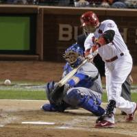 Cardinals claim National League pennant in rout