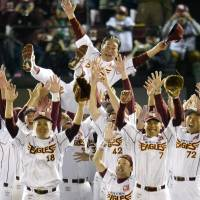 The Eagles have landed: The Tohoku Rakuten Golden Eagles throw manager Senichi Hoshino into the air after beating the Chiba Lotte Marines 8-5 on Monday to book their place in the Japan Series. | KYODO