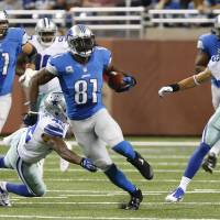 Lions' Johnson hauls in jaw-dropping 329 yards receiving