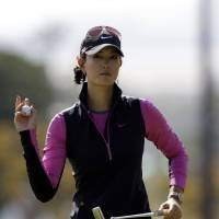 Two back: Michelle Wie reacts after making a putt on the third hole during the first round of the KEB Hana Bank Championship on Friday. Wie shot a 69 and is two strokes off the pace. | AP