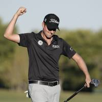 Finish the job: Webb Simpson reacts after sinking a putt on the 18th hole at the PGA's Shriners Hospitals for Children Open on Sunday. Simpson won the tournament by six strokes. | AP