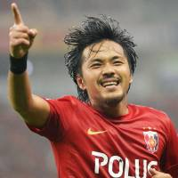 Festive atmosphere: Urawa's Shinzo Koroki celebrates his second-half goal against Omiya on Saturday in the J.League. Reds defeated Ardija 4-0. | KYODO
