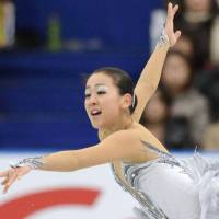 Compete and entertain: Mao Asada skates to 'Swan Lake' on Saturday in Rifu, Miyagi Prefecture. | KYODO