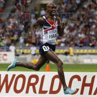 Weighing in: Double Olympic gold medalist and world champion Mo Farah says he is proud to run for England and Britain despite not being born in the United Kingdom. | AP