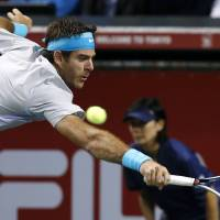 One to go: Argentina's Juan Martin del Potro plays a shot from Spain's Nicolas Almagro during their semifinal at the Rakuten Open on Saturday. Del Potro won 7-6 (9-7), 7-6 (7-1), | AP