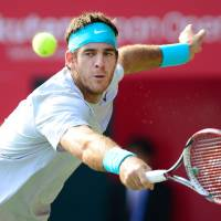 Last man standing: Juan Martin del Potro plays a shot during his 7-6 (7-5), 7-5 win over Milos Raonic in the final of the Japan Open on Sunday. | AFP-JIJI