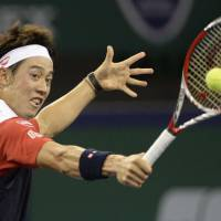 Aiming for the top: Kei Nishikori competes against Bulgaria's Grigor Dimitrov in the first round of the Shanghai Rolex Masters on Tuesday night. Nishikori beat Dimitrov 6-3, 6-4. | KYODO