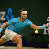 Tiebreak tension: Rafael Nadal plays a shot during his 7-6 (12-10), 6-1 quarterfinal win over Stanislas Wawrinka at the Shanghai Rolex Masters on Friday night. | AFP-JIJI
