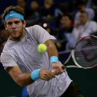 Banner night: Juan Martin del Potro hits the ball to world No. 1 Rafael Nadal in the Shanghai Rolex Masters semifinals on Saturday night. Del Potro topped Nadal 6-2, 6-4. | AFP-JIJI