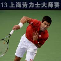 Master blaster: Novak Djokovic plays a shot during his 6-2, 3-6, 7-6 (7-3) win over Juan Martin del Potro in the final of the Shanghai Rolex Masters on Sunday. | AFP-JIJI