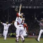Boston Strong: Koji Uehara (left) jumps into the arms of catcher David Ross as the Red Sox celebrate after winning the 2013 World Series on Wednesday at Fenway Park.