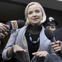 Electrifying: Domnica Cemortan speaks to the media after testifying in the trial of Costa Concordia Capt. Francesco Schettino, in Grosseto, Italy, on Tuesday. The Moldovan dancer, who was on the bridge when the Costa Concordia crashed into a reef, has testified that she was Schettino's lover | AP