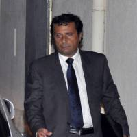 Man overboard: Capt. Francesco Schettino leaves after a hearing at his trial in Grosseto, Italy, on Monday | AP